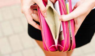 Open and empty pink women's wallet