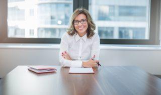 young pretty leader of small company , female CEO