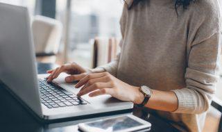 Young woman using laptop as an entrepreneur